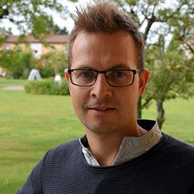 Ett porträttfoto av Nils Kirsten.